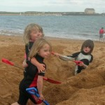 Digging holes on Elie beach