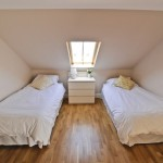 double bedroom with 2 white beds