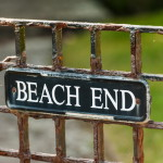 beach end sign on metal gate